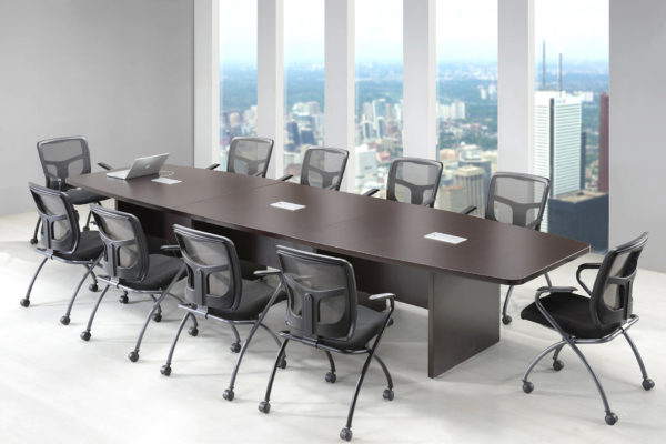 Office table located in a high-rise skyscraper boardroom