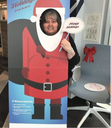 Source Kelowna receptionist Sally Peterson taking a picture as Santa